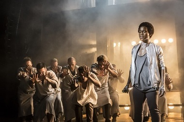 Tyrone Huntley as Judas and Ensemble. Photo Johan Persson small